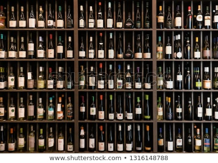 Bottles of red and white wine in rows in wine shop Stock photo © dashapetrenko