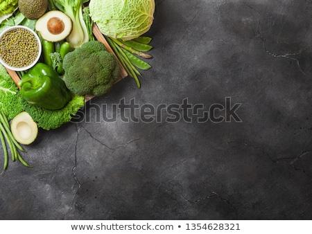 assorted green toned raw organic vegetables on dark background avocado cabbage broccoli cauliflo stock photo © denismart