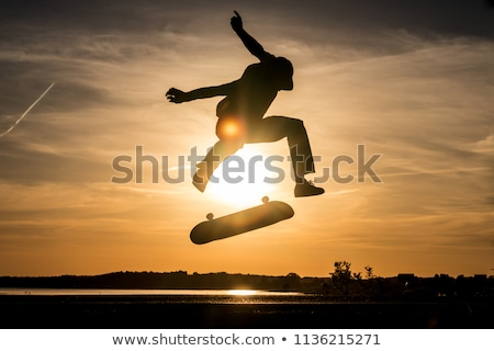 silhouette skater skateboarder stock photo © krisdog