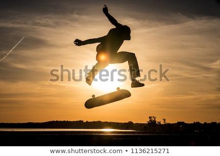 Sziluett görkorcsolyázó gördeszkás magas minőség rendkívül Stock fotó © Krisdog