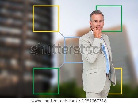 businessman and colorful mind map over city background stock photo © wavebreak_media