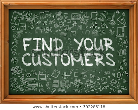 Target Your Customers Drawn Concept On Chalkboard Foto stock © Tashatuvango