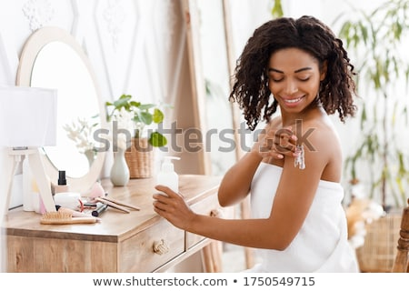 Attractive female wrapped in white towel stock photo © dash