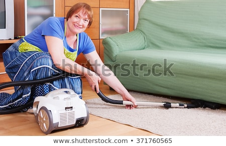 Woman vacuuming in senior woman's house Stock photo © photography33