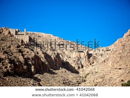 Mosteiro edifício parede montanha rocha Ásia Foto stock © Dserra1
