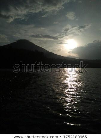 Dél naplemente naplementék hullámok távoli otthon Stock fotó © jeayesy