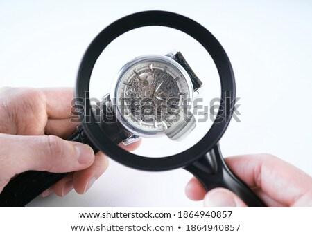 The male hand with magnifier and clockwork Stock photo © master1305