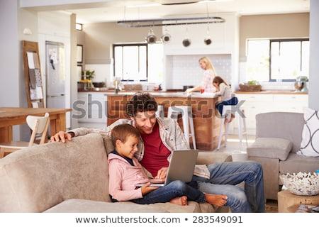 Apa fia laptopot használ nappali otthon ház szeretet Stock fotó © wavebreak_media