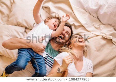 Happy young family in bed Stock photo © IS2
