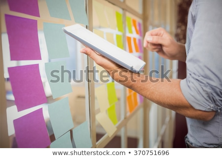 colorful sticky notes over the businessmans clothes stock photo © kzenon