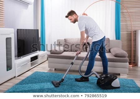 Man stofzuiger home huishouden huishoudelijk werk schoonmaken Stockfoto © dolgachov