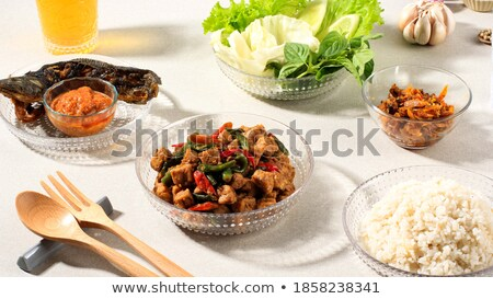 Fried catfish rice with sambal Stock photo © szefei