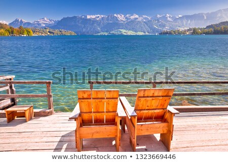 Relax deck chair by lake Luzern in Alps stock photo © xbrchx