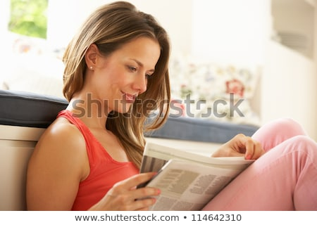 happy woman reading newspaper at home stock photo © dolgachov
