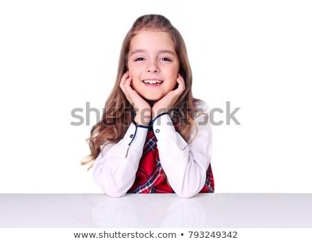 Portret szczęśliwy uczennica posiedzenia biurko Zdjęcia stock © wavebreak_media