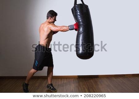 Póló nélkül izmos boxoló homokzsák tornaterem férfi Stock fotó © Jasminko