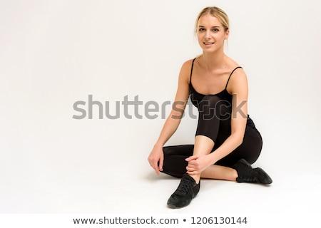 Woman practices yoga asana utthita Virabhadras Stock photo © dmitry_rukhlenko