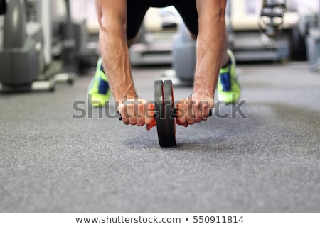 Man using an ab roller (exercise wheel) Stock photo © photography33