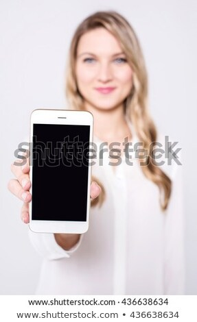 Young model displaying newly launched mobile Stock photo © stockyimages