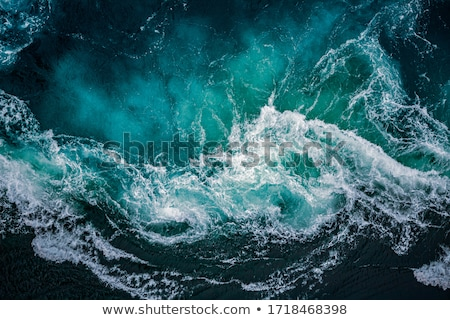Ocean with breaking waves Stock photo © jrstock