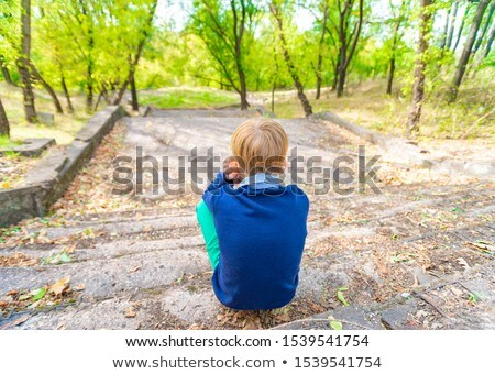 A Cute Boy sitting down  Stock photo © bluering