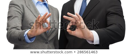 smiling african woman showing ok sign at office Stock photo © dolgachov