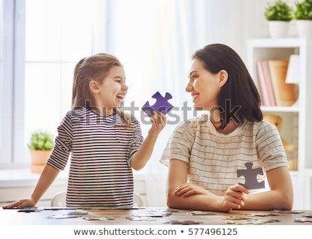 Sevimli küçük kız bilmece birlikte oturma tablo Stok fotoğraf © Len44ik