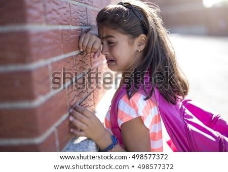 triest · eenzaam · meisje · naast · muur · kind - stockfoto © Lopolo