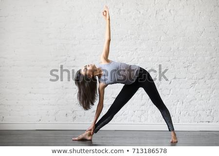 Fiatal nő jóga háromszög póz stúdió fitnessz Stock fotó © dolgachov