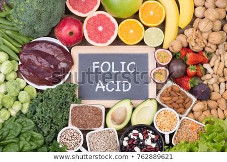 Alimentos ricos ácido saludable productos mujer Foto stock © furmanphoto
