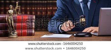 Judge Striking Gavel Near Mallet And Laptop Stock photo © AndreyPopov