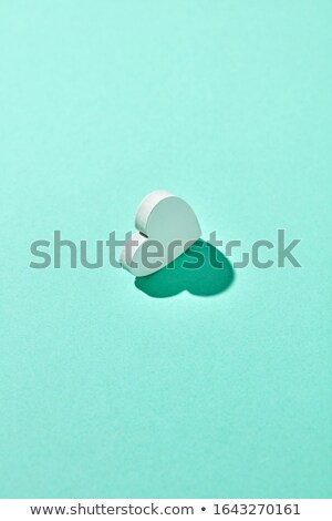 One gypsum Valentine's heart with hard shadow. Stock photo © artjazz