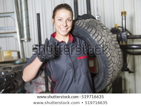 Mechanic Woman Working On Car In His Shop Foto stock © Lopolo