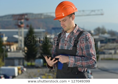 manual worker holding computer stock photo © photography33