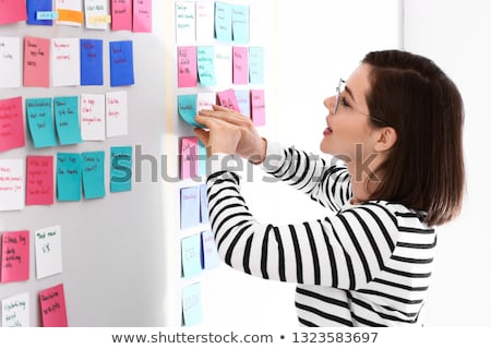 Woman noting an appointment. Stock photo © photography33