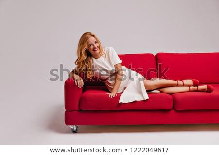 Mulher vermelho sofá mulheres jovens surfe Foto stock © dash