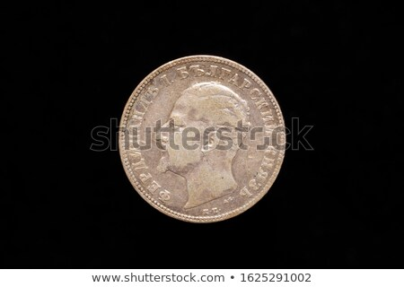 two old european coins on a black background stock photo © tashatuvango