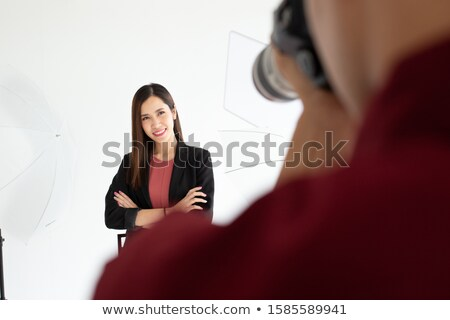 beautiful businesswoman posing at camera in office stock photo © nenetus