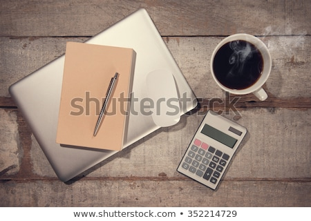 Stock photo: Taxes on wooden table