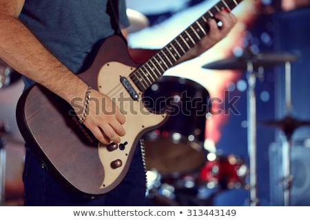 молодые · мужчины · гитарист · играет · электрической · гитаре · волос - Сток-фото © sumners