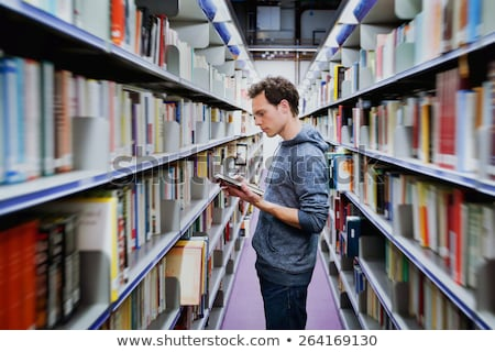 egyetemi · hallgató · kiválaszt · könyv · könyvtár · polc · férfi - stock fotó © vlad_star