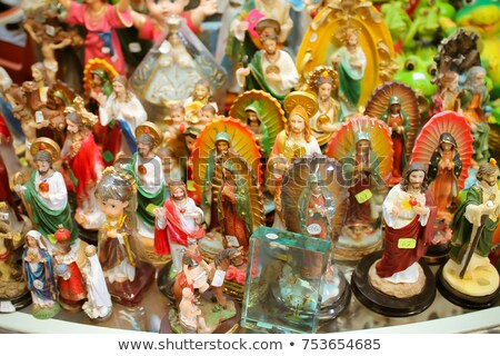 saint and virgin  figurines in mexican market Stock photo © lunamarina