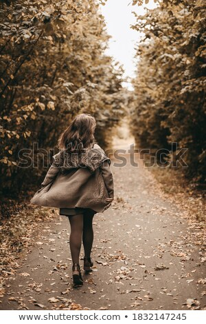Young woman in knitted dress in the park Stock photo © boggy