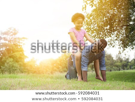 Father gives little girl piggy back ride Stock photo © colematt