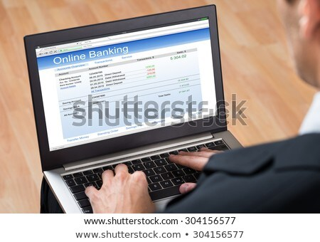 businessperson doing online banking on tablet stock photo © andreypopov