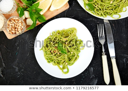 Olasz tészta spagetti házi készítésű bazsalikom pesztó Stock fotó © Illia