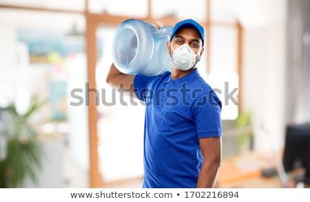 Boldog indiai futár víz hordó szolgáltatás Stock fotó © dolgachov