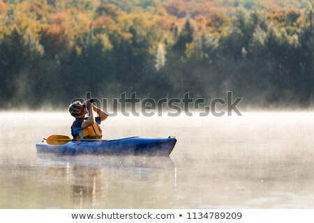 Férfi madárles csónak tó természet madarak Stock fotó © Kzenon