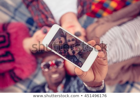 happy teenage couple taking selfie on summer grass Stock photo © dolgachov