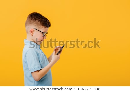 Profile shot of a smartly dressed young kid Stock photo © stockyimages